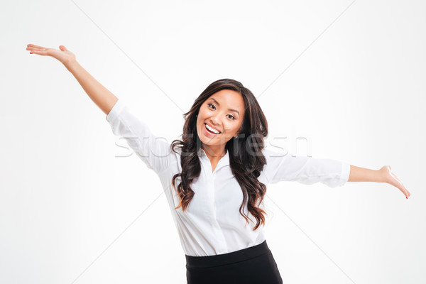 Portrait of a happy asian busineswoman with raised hands up Stock photo © deandrobot