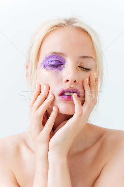 Tender young woman with stylish makeup and closed eyes Stock photo © deandrobot