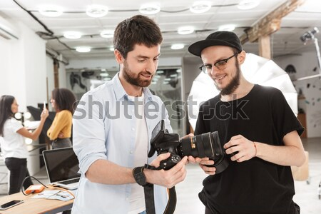 Man with gun trying to steal purse of frightened lady Stock photo © deandrobot
