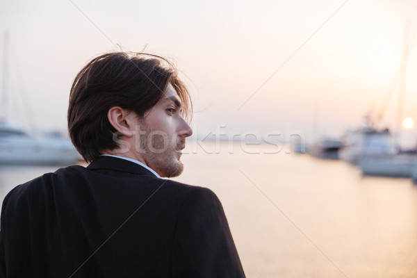 Man in suit from behind Stock photo © deandrobot