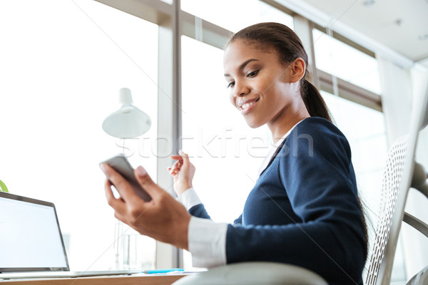 From below image of business woman with phone Stock photo © deandrobot