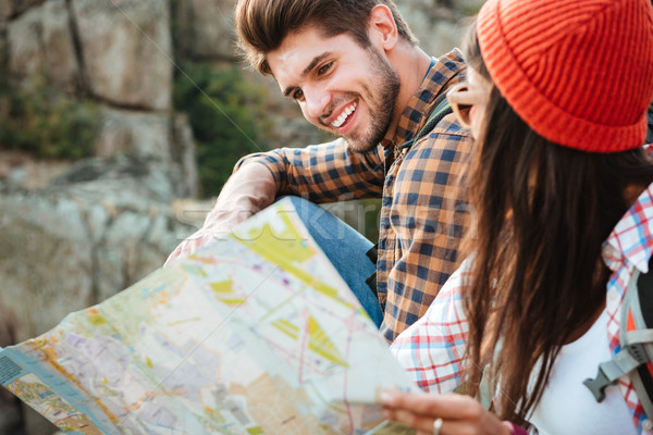 Cropped image of adventure couple with map Stock photo © deandrobot