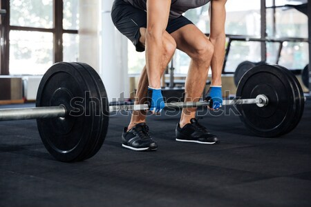 Cropped portrait of fitness man with barbell Stock photo © deandrobot