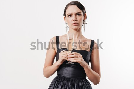 Serious fitness woman holding heavy bardell with teo hands Stock photo © deandrobot