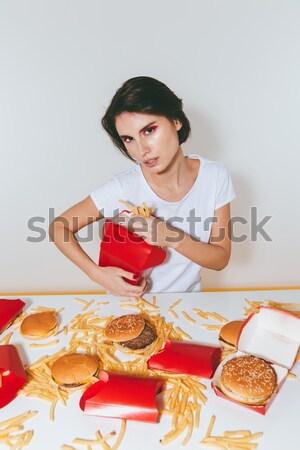 Sensual dedo comer de comida rápida blanco Foto stock © deandrobot