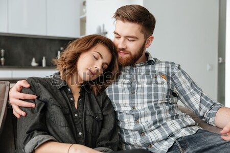 Loving couple standing in kitchen drinking alcohol. Stock photo © deandrobot