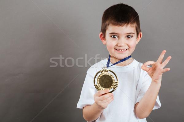 счастливым мало мальчика медаль Сток-фото © deandrobot
