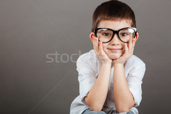 Portrait of cute little boy in glasses and white shirt Stock photo © deandrobot