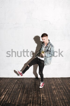 Vertical image of Hipster in snap back flying on mop Stock photo © deandrobot