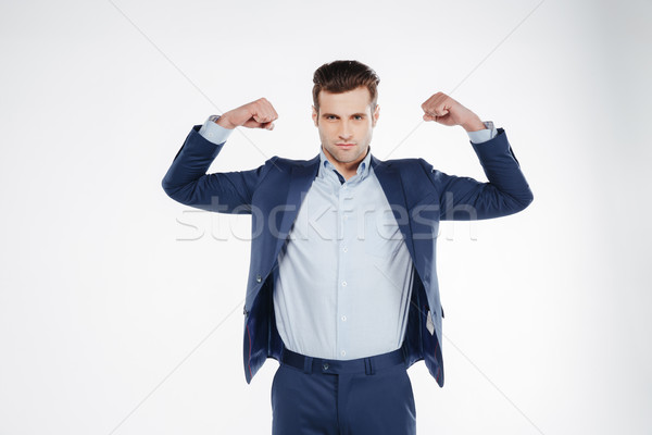 Homme costume biceps bleu regarder Photo stock © deandrobot