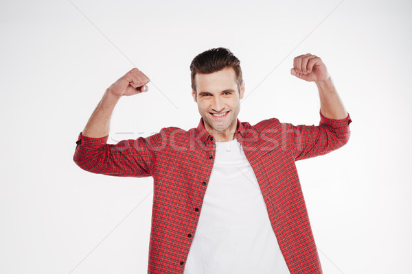 Portrait souriant homme biceps shirt Photo stock © deandrobot