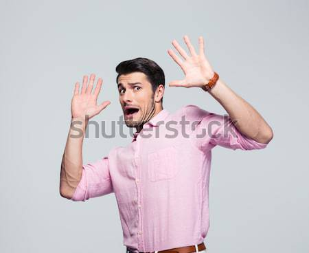 Scared man with open mouth Stock photo © deandrobot