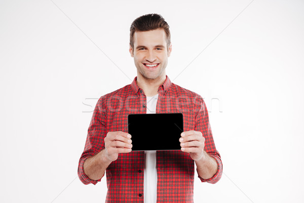 Stock photo: Smiling man showing blank tablet computer screen