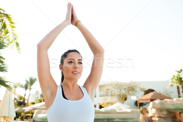 Attractive young fitness lady make yoga exercises Stock photo © deandrobot