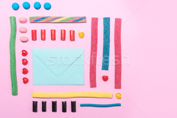 Stock photo: Photo of blank paper envelope with colorful sweet sugar candies