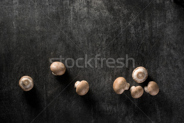 Top view photo of a mushrooms Stock photo © deandrobot