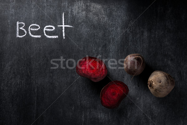 Cut beet over dark chalkboard background Stock photo © deandrobot