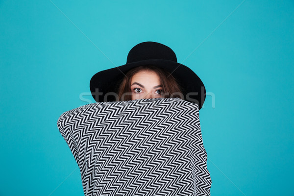 Fiatal lány kalap fedett pléd néz kamera Stock fotó © deandrobot