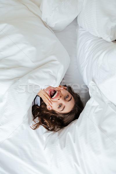 Jonge dame bed home Stockfoto © deandrobot