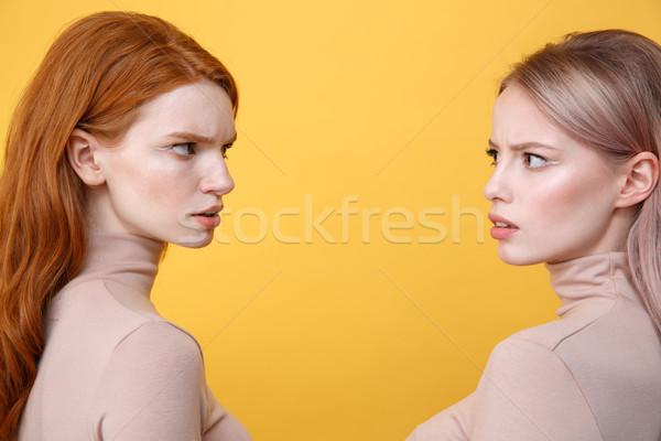вид сбоку фотография сердиться молодые два дамы Сток-фото © deandrobot