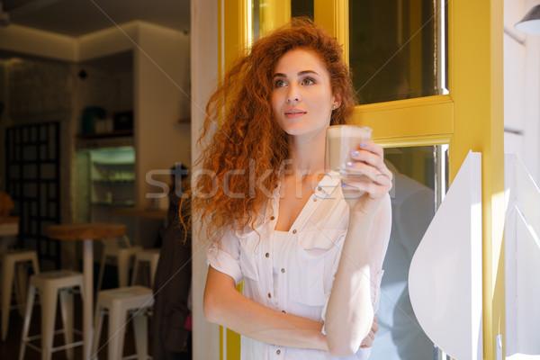 Cute femme cheveux longs tasse Photo stock © deandrobot