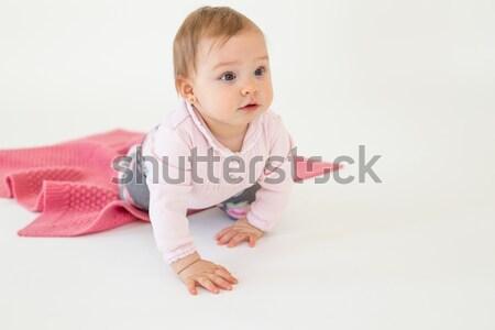 Aranyos csinos kicsi kislány ül padló Stock fotó © deandrobot