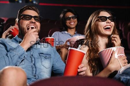 Shocked friends sitting in cinema watch film Stock photo © deandrobot
