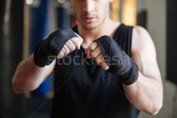 Imagem boxeador em pé ginásio foco mãos Foto stock © deandrobot