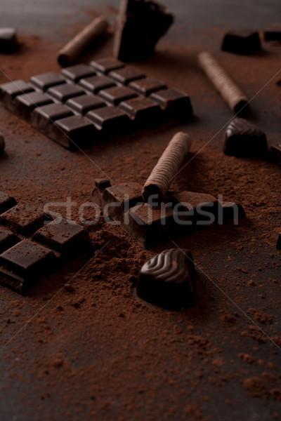 Close up of chocolate bar crashed into pieces Stock photo © deandrobot