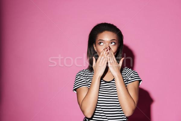 Geschokt afrikaanse meisje portret Stockfoto © deandrobot