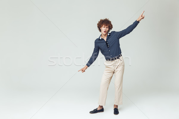 Emotional young retro man dressed in shirt Stock photo © deandrobot