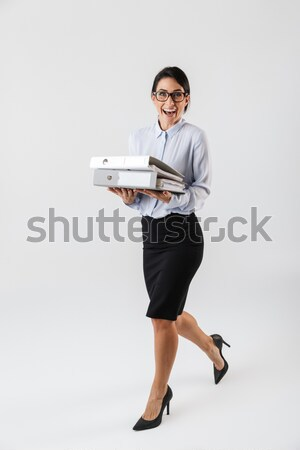 Stock photo: Full length image of Cheerful blonde business woman reading newspaper