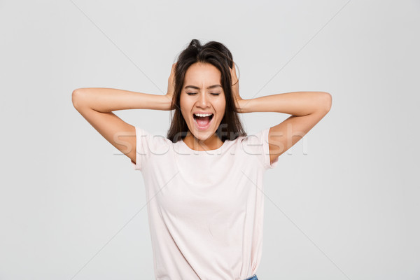 Portrait of frustrated irritated asian woman Stock photo © deandrobot