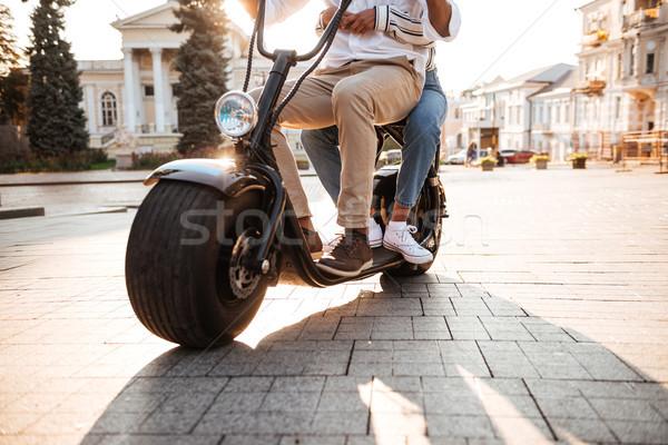 Imagem africano casal moderno motocicleta rua Foto stock © deandrobot