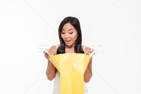 Сток-фото: портрет · возбужденный · азиатских · женщину · глядя · внутри