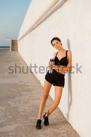 Smiling lady making exercises while training Stock photo © deandrobot