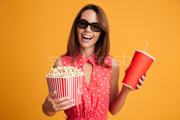 Happy brunette woman in dress and eyeglasses preparing to watch Stock photo © deandrobot