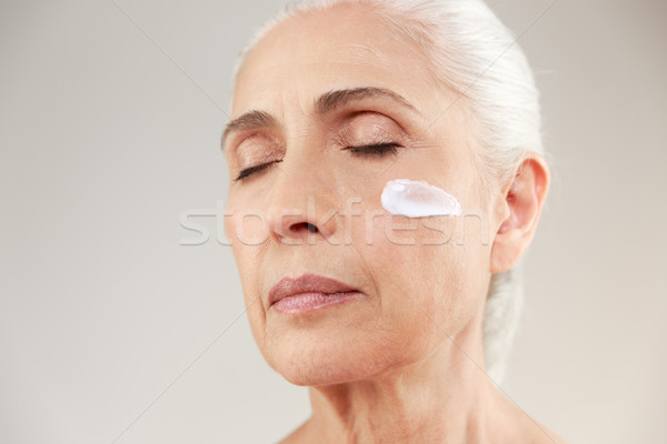 Close up beauty portrait of a tranquil elderly woman Stock photo © deandrobot