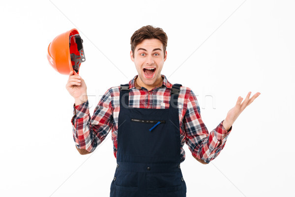 Portrait of a happy young male builder celebrating Stock photo © deandrobot