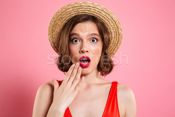 Close up portrait of a shocked pretty girl Stock photo © deandrobot