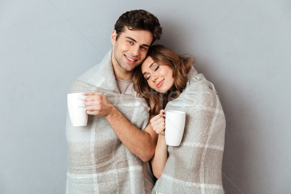 Portrait of a pleased smiling couple Stock photo © deandrobot