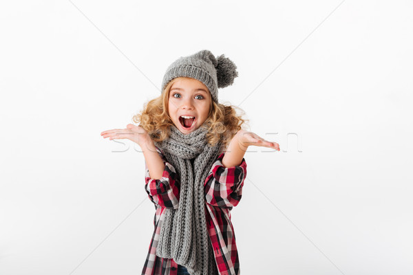 Portrait of a happy little girl dressed in winter hat Stock photo © deandrobot