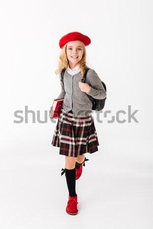 Ritratto piccolo studentessa uniforme zaino Foto d'archivio © deandrobot