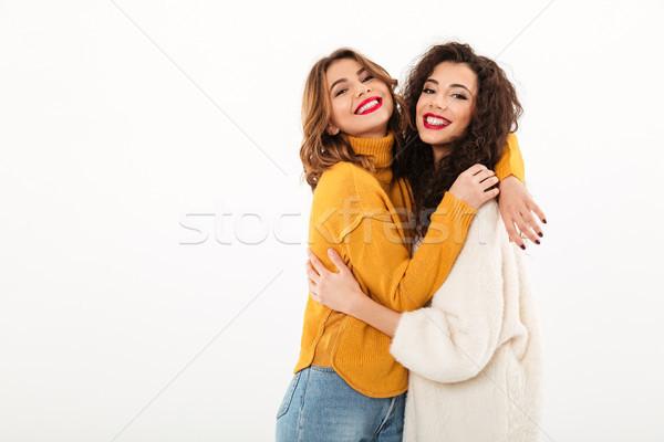 Dwa zadowolony dziewcząt inny patrząc Zdjęcia stock © deandrobot