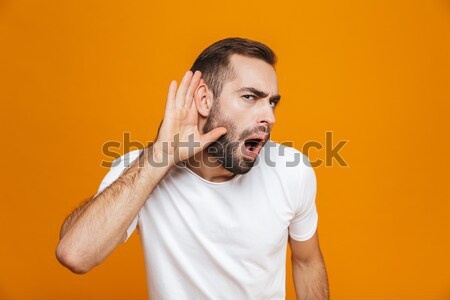 Happy screaming man in shirt rejoice and looking at camera Stock photo © deandrobot