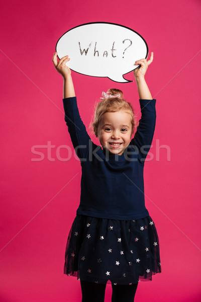 Függőleges kép boldog fiatal lány tart szövegbuborék Stock fotó © deandrobot