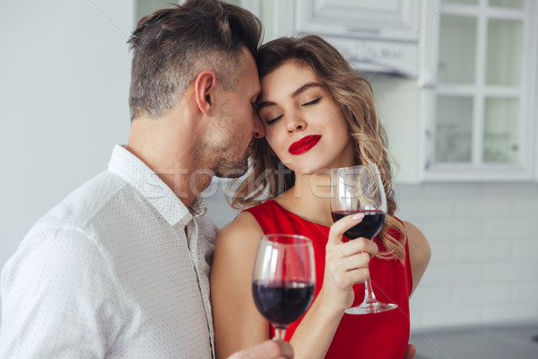Young woman enjoying kisses of her handsome man Stock photo © deandrobot