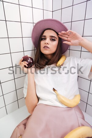 Portrait of an upset girl dressed in tank-top Stock photo © deandrobot