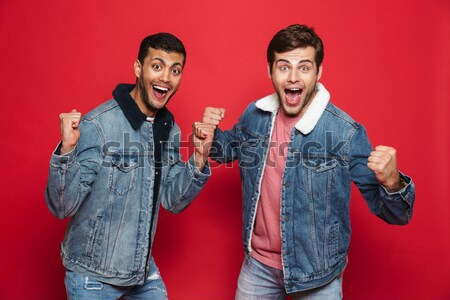 Happy punk woman showing the money while punk man posing Stock photo © deandrobot