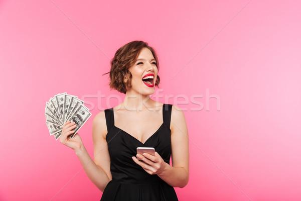 Portret podniecony dziewczyna czarna sukienka Zdjęcia stock © deandrobot